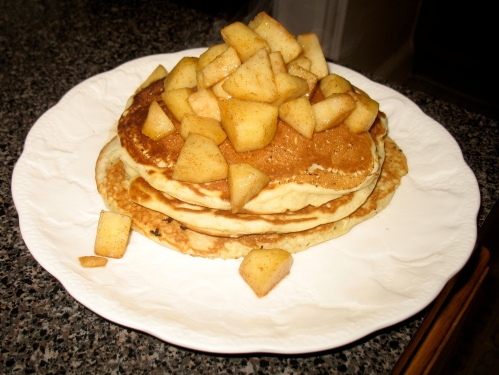 Pancakes with bacon hidden inside, topped with apples